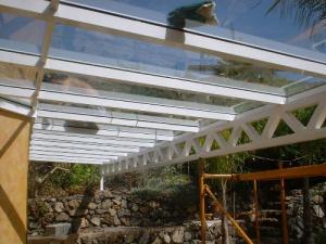 Glasdach über 11 m freitragend auf Fachwerkträger
